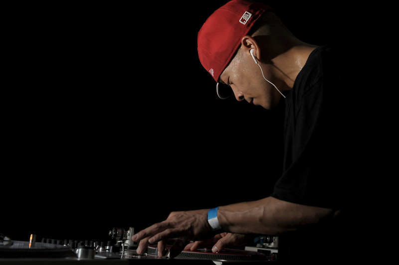 DJ Qbert<br /> San Francisco, CA<br /> <br /> Richard Quitevis, better known as DJ Qbert to fans throughout the world, has attracted attention since 1985 when audiences realized his skills on the turntables were beyond comprehension. Through years of creativity, imagination, practice, and dedication he developed the art of using the turntable as a musical instrument by inventing unimaginable styles and creating unique systems of skratching. Today turntablism continues to advance and branch out into diversified directions. History established that DJ Qbert, currently a member of the Invisibl Skratch Piklz (ISP), heralded a new era in the DJ/turntablist community, and helped raise this art to its new form.<br /> <br /> Heavily influenced by the styles of world-renowned jazz musician Miles Davis, famous electric guitarists Jimmy Hendrix and Les Paul, pianist Thelonius Monk, and original and innovative DJs throughout the world, DJ Qbert interprets their compositions to create sounds and styles that continue to generate a worldwide following. In the early 90's, DJ Qbert dominated the DJ scene with his talent and skills. After claiming the titles of the Disco Mixing Club (DMC) 1991 USA Champion and the 1992-1994 DMC World Champion, he was asked by the DMC founders to judge the 1995 DMC Championships instead of actually competing. In June 1998, DJ Qbert, along with another member of ISP, MixMaster Mike, received the DMC DJ Hall of Fame award for outstanding contributions to the competition and more importantly, the industry.<br /> <br /> The most documented DJ in the world, DJ Qbert has been featured in numerous local and national publications including Details, XXL, Spin, Jazziz, and the Bay Area Magazine (BAM), as well as international magazines and newspapers. In January 1998, DJ Qbert and the ISP crew graced the cover of the highly circulated URB magazine.<br /> <br /> Also in 1998 DJ Qbert appeared in two international movies: Hang The DJ and Modulations. Both films a