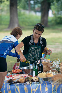 Trek Travel guides Monica Morrison and Andrea Meholic prepare a gourmet picnic of local specialties, including a variety of Czech beers, in the Vyšší Brod Park.
