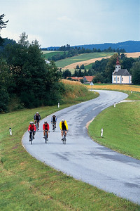 Trek Travel guests ride the pastoral country roads in the Vltava River valley outside of the historic town of Rožemberk.