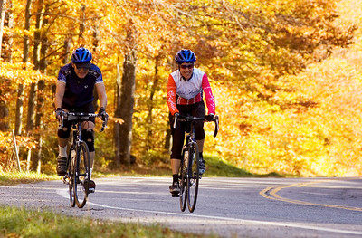 Trek Travel guests pedaling their way to Middlebury Vermont through falls' vibrant canopy