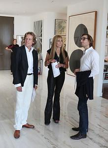BEVERLY HILLS, CA - OCTOBER 1: (L-R) Stefan Hildebrandt, Rosette Delug and Paul McCabe pose during a VIP tour the Rosette Delug art collection at her home on October 1, 2011 in Beverly Hills, California. (Photo by Ryan Miller/Capture Imaging)
