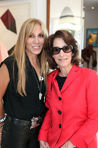 BEVERLY HILLS, CA - OCTOBER 1: Collector Rosette Delug (L) and Joan Weinstein, Deputy Director Getty Foundation (R) during a VIP tour the Rosette Delug art collection at her home on October 1, 2011 in Beverly Hills, California. (Photo by Ryan Miller/Capture Imaging)