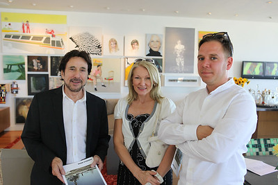 BEVERLY HILLS, CA - OCTOBER 1: (L-R) Joel Gilman, Tatiana Freman and artist Andreas Muhe pose during a VIP tour the Rosette Delug art collection at her home on October 1, 2011 in Beverly Hills, California. (Photo by Ryan Miller/Capture Imaging)