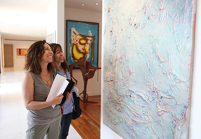 BEVERLY HILLS, CA - OCTOBER 1: Dori Mostov (L) and Nancy Goldstein (R) look at the art during a VIP tour the Rosette Delug art collection at her home on October 1, 2011 in Beverly Hills, California. (Photo by Ryan Miller/Capture Imaging)