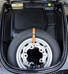 Spare tire takes up much of  the trunk space.