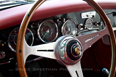Wood and aluminum steering wheel adds an elegant touch to the pretty interior.