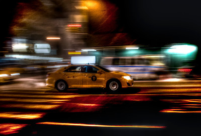 Speeding taxi in Manhattan.  ©Brian Glantz