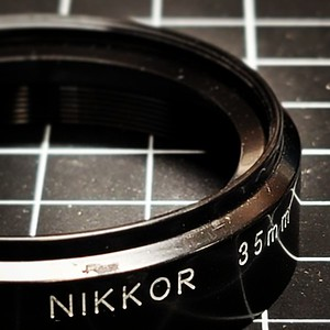 Nikkor 35mm 1.4 on the bench.