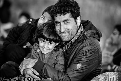 A family rests on the beach while looking at the sea where they just come from. Lesvos Island, Greece, 2015 ---- Une famille se repose sur la plage en regardant la mer d'où ils arrivent. Ile de Lesbos, Grèce, 2015