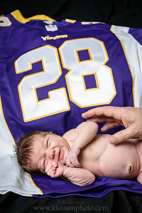 I'd cry too, if my parents made me lay on a Vikings jersey... :)