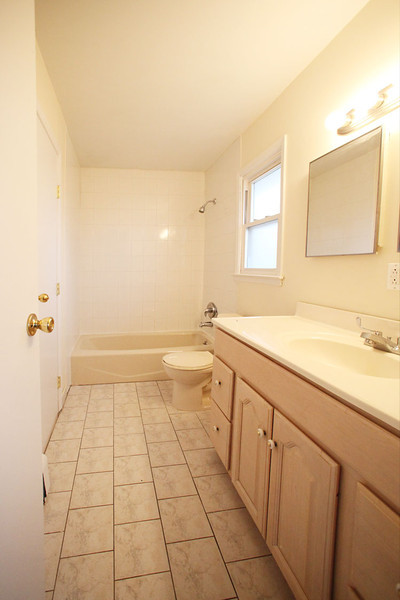 Upstairs full bathroom.  Has access from Master Bathroom and upstairs hallway.