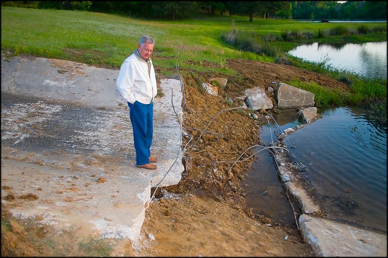Ken Terrell inspects repair work in progress on Lake #2 dam