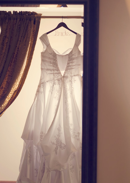 Wedding dress hanging in a room at the Waukesha Rotunda.