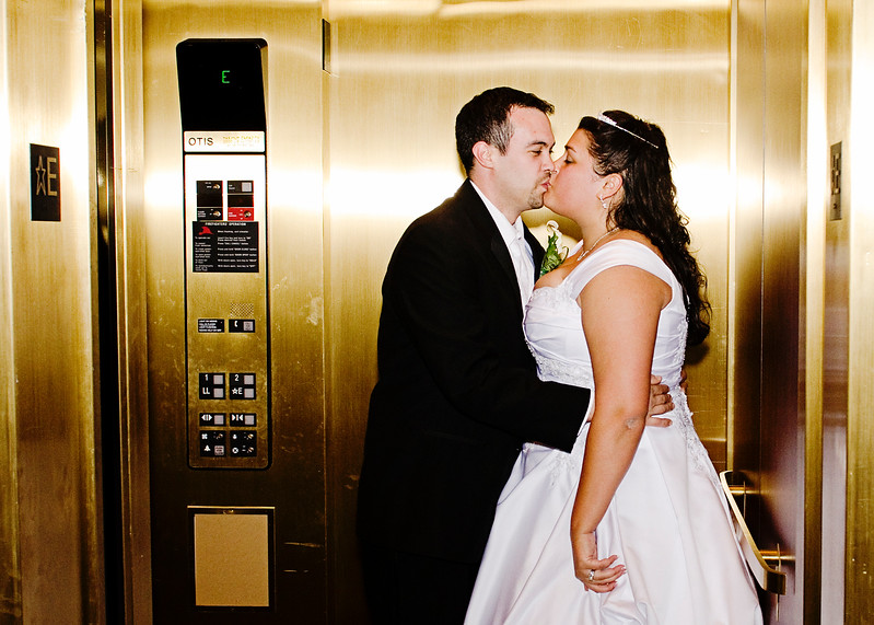 Sneak peak of married couple in the elevator of the Rotunda.