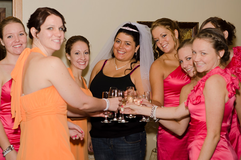Lovely ladies of the wedding party, toasting the happy day.