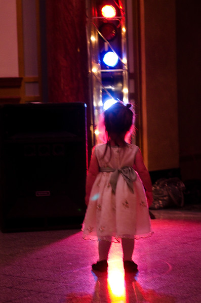 Girl mesmerized by lights on the dance floor.
