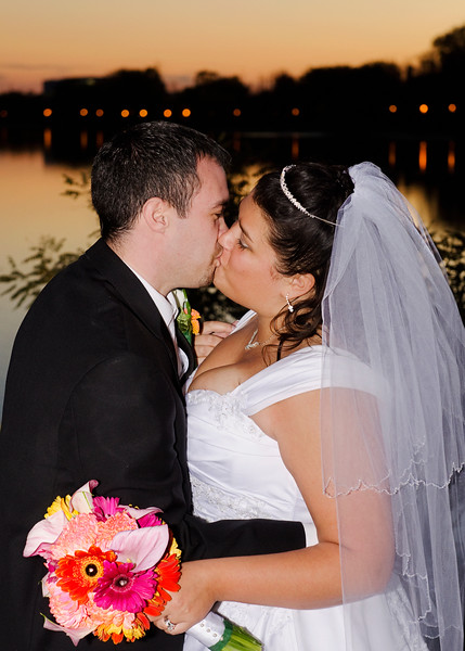 Caitlin and Chad's first photos as a married couple, overlooking the Fox River in Frame Park.