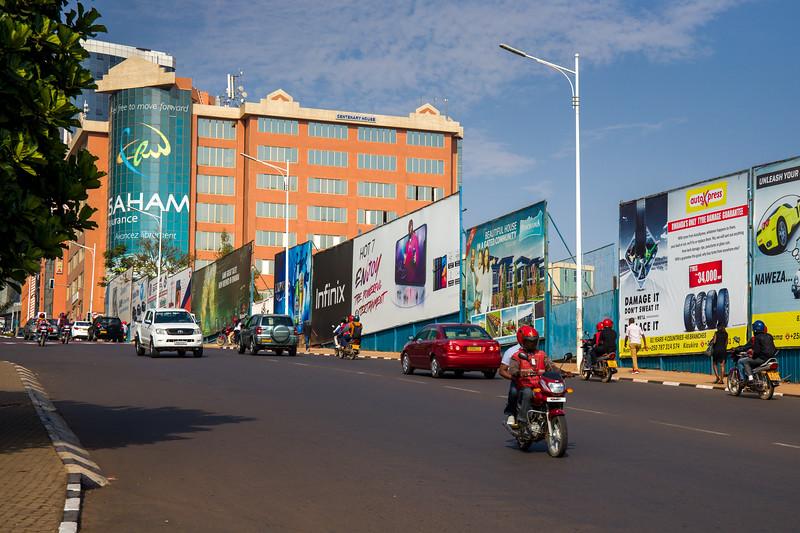 Centenary house and street scene on a sunny summer morning in Kigali Rwanda.