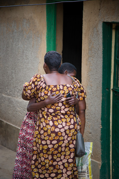 Odethe greets a widow with HIV.