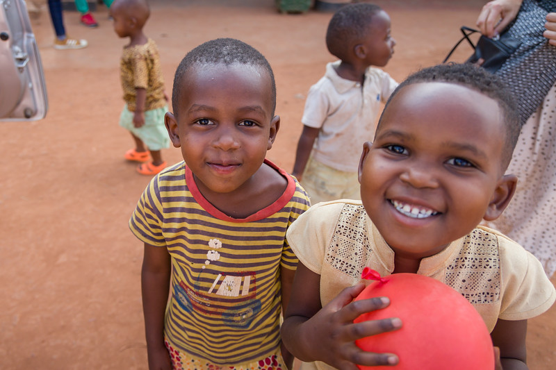 Children play outside of Mamma Joy's ministry which is helping former prostitutes learn new skills so that they can support themselves and their families.