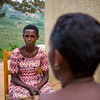 A widow and victim of the genocide sits for an interview with the PEACE team to tell her story in Kigali Rwanda.