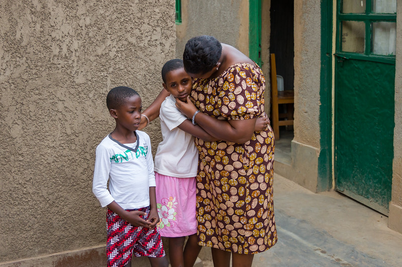 Odethe greets the children of a widow with HIV.