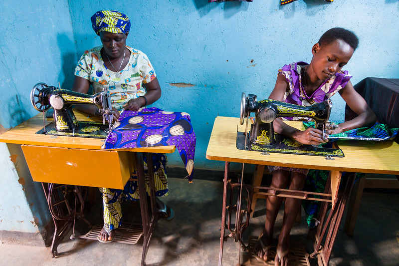 Women sew at Mamma Joy's ministry which is helping former prostitutes learn new skills so that they can support themselves and their families.