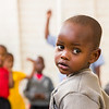 A young boy looks over his shoulder during recess at a pre-school in Kigali Rwanda