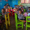 Pre-school children finish up their snack at a PEACE school in Kigali Rwanda.