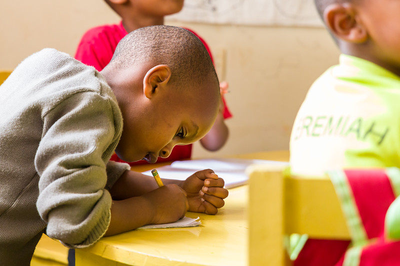 Students take an exam in pre-school at a PEACE sponsored school in Kigali Rwanda
