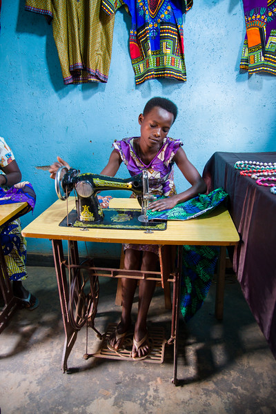 A woman sews at Mamma Joy's ministry which is helping former prostitutes learn new skills so that they can support themselves and their families.
