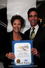 Bonnie J. Addario and Mark Leno holding California Legislature Assembly Certificate of Recognition for the Foundations' work.