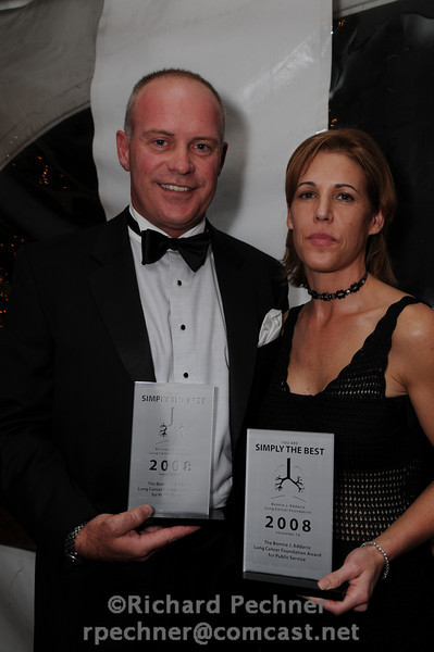 Robert Schmitt and  Cathy Matthews from CBS Outdoor, holding the Bonnie J. Addario Lung Cancer Foundation Award for Public Service