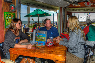 A family enjoys a few drinks inside Oceanfront Bar & Grill on the Boardwalk in Myrtle Beach, SC on Sunday, March 11, 2012. Copyright 2012 Jason Barnette