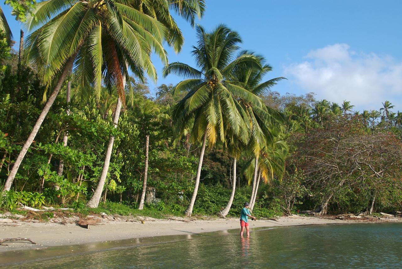 A female fly fisherman casts off of Panama's San Blas islands