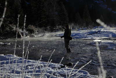 A fly fisherman on a very cold winter morning on the San Miguel river near Telluride Colorado