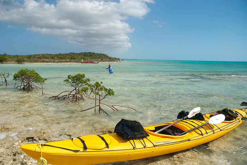 Dave Trevithick (near) and Tim Candon (far) beach there kayaks and cast to cruising Bonefish on a remote kayaking trip in the Exuma Islands, Bahamas.