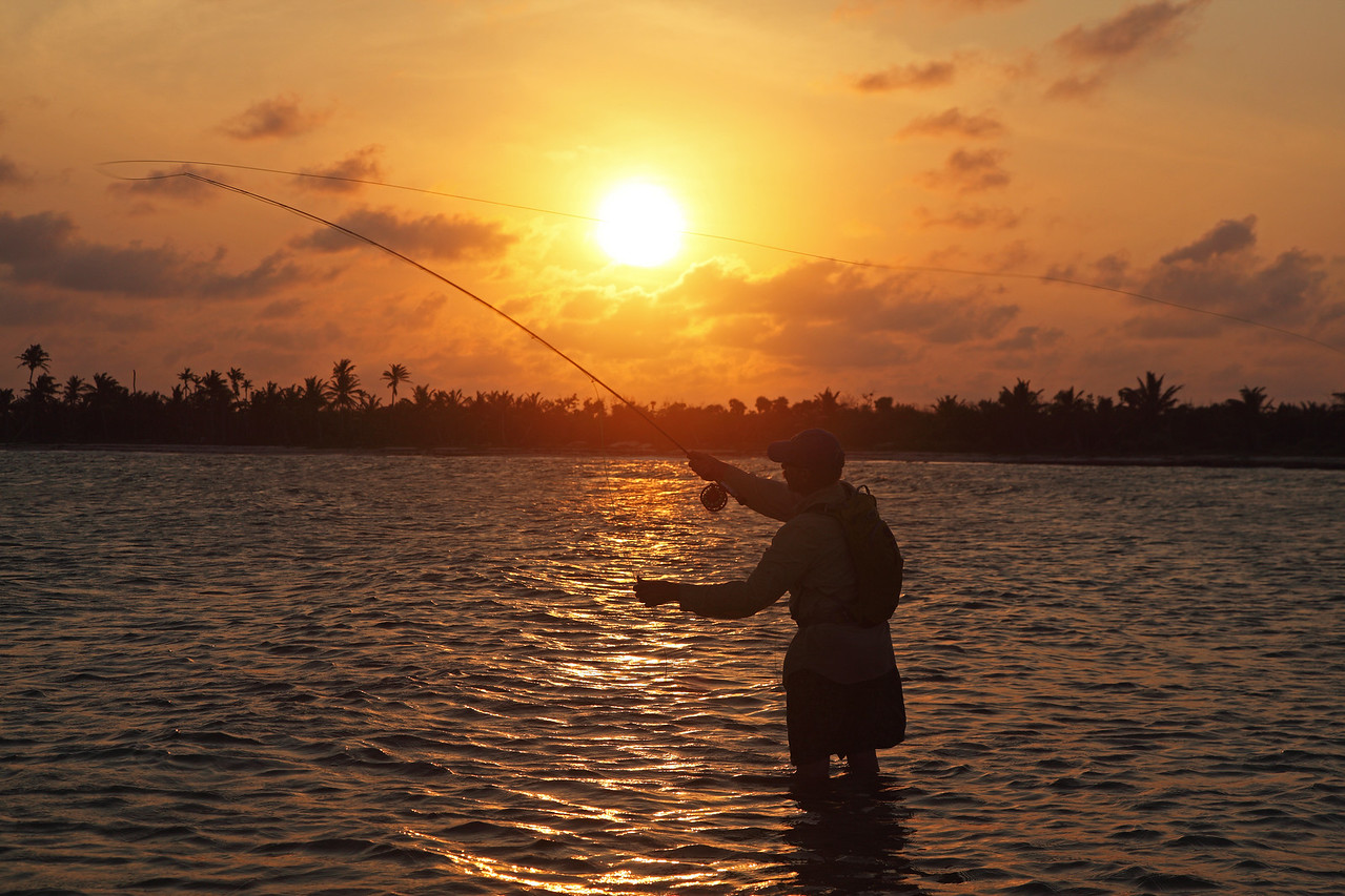 A fly fisherman casting for Bonefish at sunset in Mexico