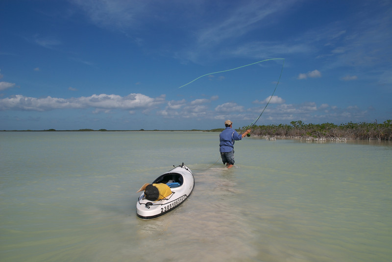 A fly fisherman casts to Bonefish while trailing his kayak at Boca Paila Mexico