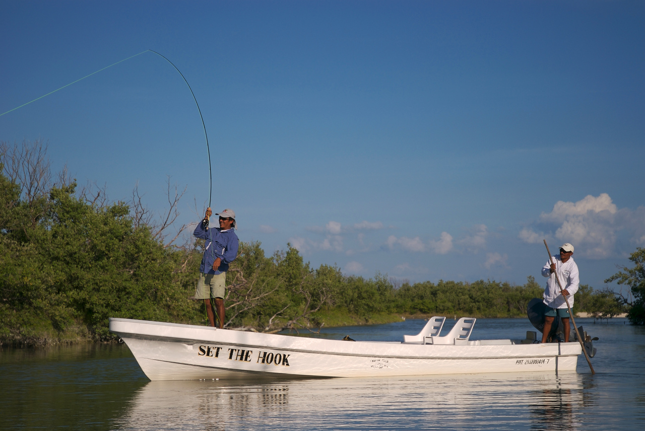 A fly fisherman with a Tarpon on, Isla Holbox Mexico