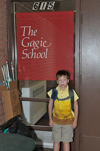 Joey (not feeling too well with a 103  degree fever... he didn't go today, just said 'hi' to his friends from a distance) stands outside the building where he will be attending 1st grade.