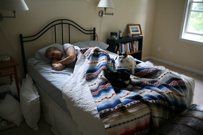 Here I am pregnant, super-nauseous, having hormone induced hot-flashes & covered with cats. Cats love a hot, tired pregnant woman.<br /> <br /> Side note: how tiny was our bed? No wonder I didn't get pregnant.
