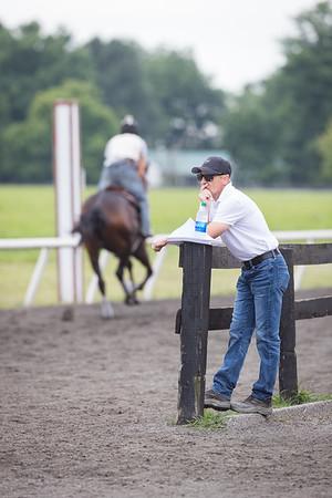 Tom Drury watches his horses train at Skylight Training Center 7.16.20