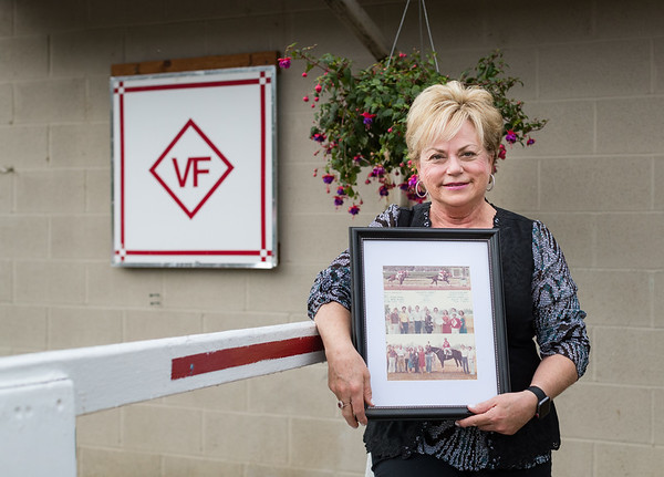Vickie, holding a win picture from 1980 at Ellis Park. Here father was the trainer, the horse (Jeanie's Fancy) was named after her mother, and Vickie appears in the Orange sundress.