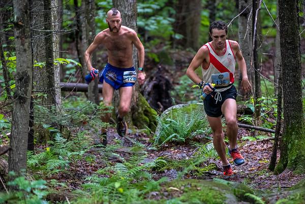 David KIlgore navigates technical single track with Derek Hamel in pursuit.