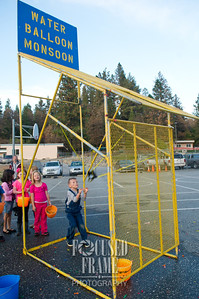 Roman Davis, a kindergarten student, launches a water balloon at the Union HIll Elementary annual Pumpkin Patch on October 25, 2013 in Grass Valley, CA. The event features games and activities run by the classes and helps raise funds for classroom activities. (Photo by Brenda Davis)