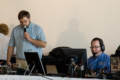 Jeff Hazenwinkel puts the finishing touches on lighting and sound while Simon Kissler prepares the video feed to IHETS