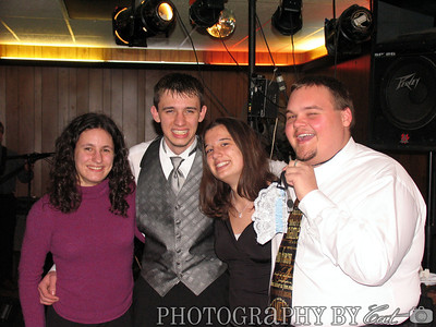 A TA shot. Cat Rodery, Adam Stradtner, Kristin Page & Larry Selvy. (At Adam's wedding) And yes, that is the garter on Larry's flash drive.