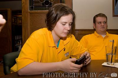 Women's Basketball: 03/12/2008 v. Milwaukee  Amanda playing with Simon's new phone.
