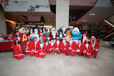 1112229-0019    CANOGA PARK, CA - DECEMBER 4: Over 500 people in Santa costumes walk during the 2nd Annual Santa Walk fundraiser benefiting Variety the Children's Charity of Southern California at Westfield Topanga on December 4, 2011 in Canoga Park, California. (Photo by Ryan Miller/Capture Imaging)